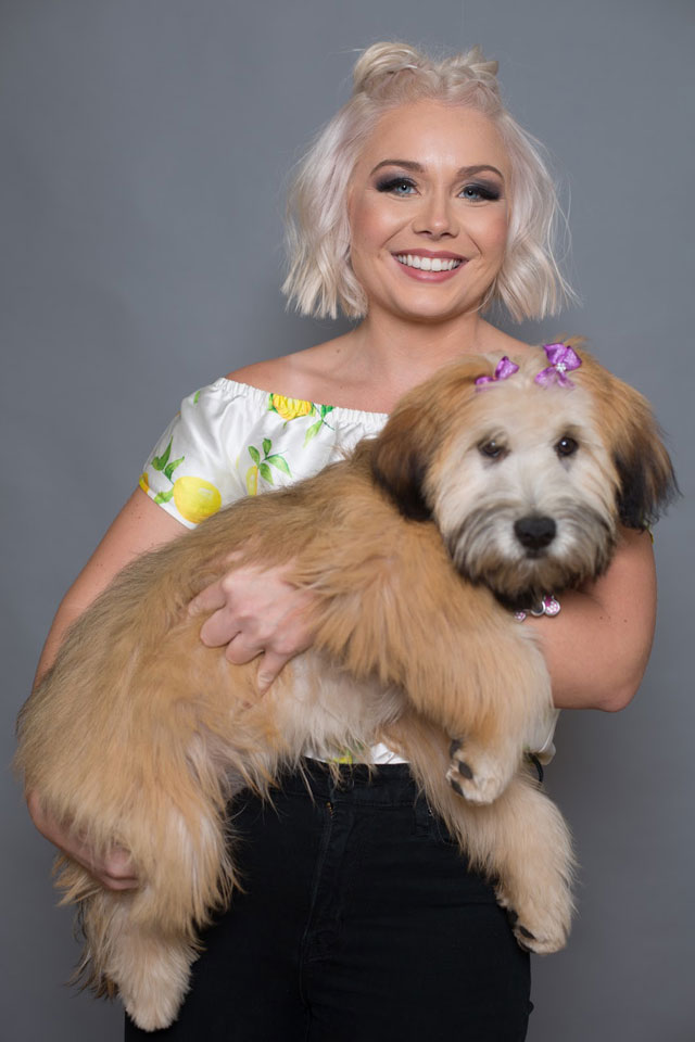 Blonde woman holding a dog