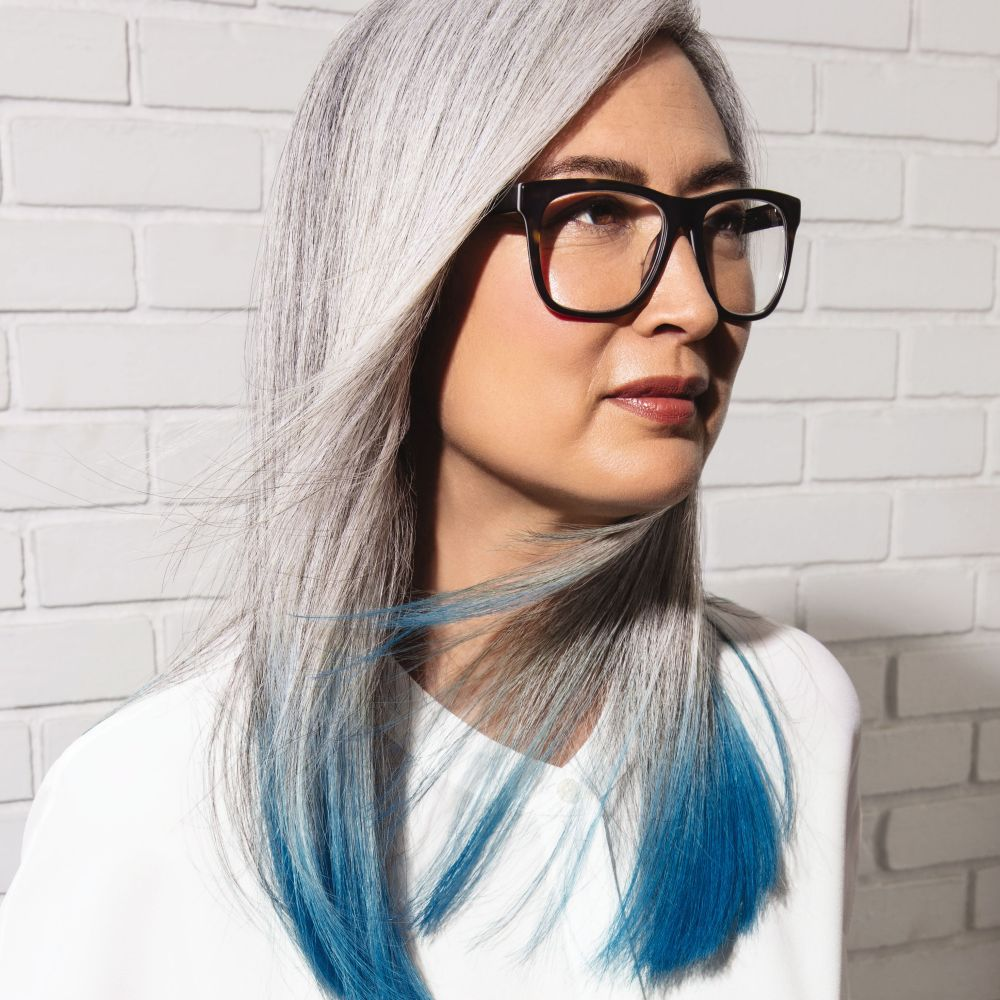 white-hair-with-teal-colored-ends